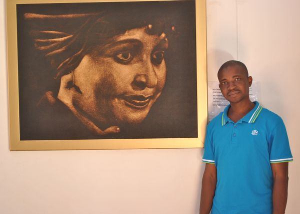 ojo in front of his portrait of winnie mandela