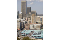 Johannesburg, Gauteng province: The city centre skyline, with the Noord Street minibus taxi rank in the foreground