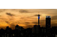 Johannesburg, Gauteng province: A view of the city centre skyline at sunset from the rooftop of the Oribi Hotel in Troyeville