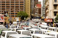 Johannesburg, Gauteng province: Minibus taxis jam Klein Street in the city centre
