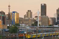 Johannesburg, Gauteng province: The Braamfontein skyline viewed across the Johannesburg Station shunting yards. The Nelson Mandela Bridge is in the foreground