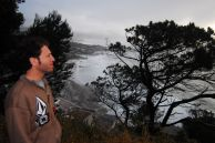 Jason Rosenstein, a musician in the South African band Sons of Trout, looks out at a storm over Clifton beach