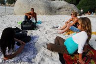 Cape Town, Western Cape province: from left, Nicole Marais, Chase van Aardt, Judith Lettier and Joy van Aardt relax on Clifton Second Beach
