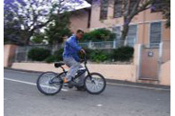 Cape Town, Western Cape province: Mohamed Isaacson pulls a power slide on his BMX bike in the suburb of Bo Kaap