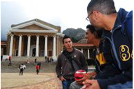 Students (from left) Byron Groves, Munier Albertus and Jesse Abrahams hang out on the steps at the University of Cape Town, Western Cape