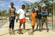 Johannesburg: Boys play with home-made toy cars made of wire in the Soweto suburb of Kliptown.
