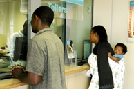 Johannesburg: Customers at First National Bank's Ikezi Agency in Dobonsonville, Soweto.
