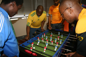 FIC staff members work their moves on the Foosball table