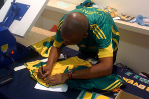 Proverb's Bafana Bafana jersey being personalised by the experts.