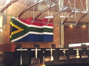 The impressive flag adds colour to the muted tones of the courtroom