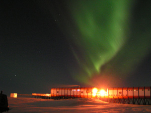 The aurora australis light up the Antarctic sky behind the Sanae IV base