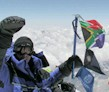 Wisedale flies the South African and Discovery flags from the top of Everest