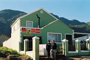 Joanna and Davy Sias outside their double-storey house